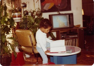 Me at 3 with the Webster's Collegiate Dictionary on a Fisher-Price Table--You can't see it but my toy stove and cooking set is in the background...