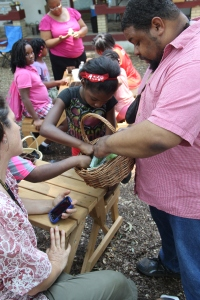 Planting with youth at an African American run urban farm in Atlanta